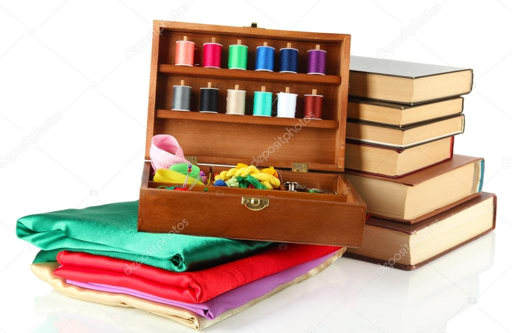 Book Cover Sewing Kits : Sewing kit in wooden box with books and cloth isolated on
