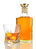 Glass of whiskey with bottle, isolated on white — Stock Photo