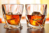 Glasses of whiskey, on bright background — Stock Photo