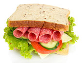 Tasty sandwich with salami sausage and vegetables, isolated on white — Stock Photo