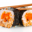 Stock Photo: Delicious sushi and chopsticks isolated on white