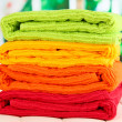 Stock Photo: Colorful towels on wooden table on window background
