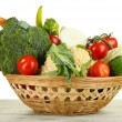Fresh vegetables in basket on wooden table on white background — Stock Photo #29426497