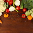 Fresh vegetables in basket on wooden table close-up — Stock Photo #29427697