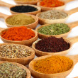 Assortment of spices in wooden spoons — Stock Photo #29428143
