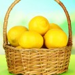 Ripe lemons in wicker basket on table on bright background — Stock Photo #29428337