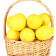 Ripe lemons in wicker basket isolated on white — Stock Photo #29428611