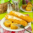 Stock Photo: Flavored boiled corn on plate on wooden table close-up