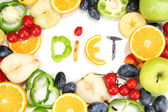 "The word ""Diet"" lined with pieces of fruits and vegetables isolated on white — Stock Photo"