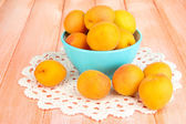 Fresh natural apricot in bowl on wooden table — Stock Photo