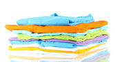 Neatly folded shirts isolated on white — Stok fotoğraf