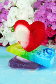 Pieces of handmade soap, on bright background — Stockfoto