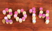 2014 laid out for wine corks on wooden table close-up — Stock Photo