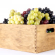 Assortment of ripe sweet grapes in wooden crate, isolated on whit — Stock Photo #29454397
