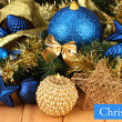 Christmas composition with candles and decorations in blue and gold colors on wooden background — Stock Photo #29454521
