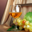 Composition of frame,wine and grapes on bright background — Stock Photo
