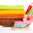 Colorful towels, cosmetics bottles and soap in basket, isolated on white — Stock Photo #29456919