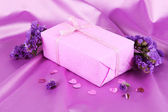 Romantic parcel on purple cloth background — Stock Photo