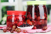 Home made berry jam on wooden table on window background — Stock Photo