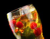 Iced tea with raspberries and mint on black background — ストック写真