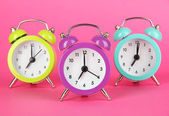 Colorful alarm clock on pink background — Foto de Stock