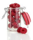 Ripe raspberries in bank isolated on white — Stock Photo