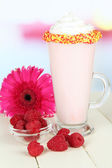 Delicious milk shake on table on light background — Stock Photo