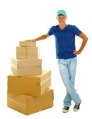 Young delivery man with parcels, isolated on white — Stock Photo