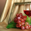 Composition of frame,wine and grapes on bright background — Stock Photo #29520215