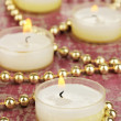 Lighted candles with beads close up — Stock Photo #29520617