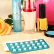 Stock Photo: Hormonal pills in women's bedside table on room background