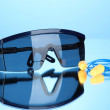 Eyeglasses tools and earplugs on blue background — 图库照片 #29520915