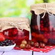 Home made berry jam on wooden table on bright background — Stock Photo #29521009