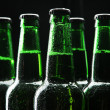 Stock Photo: Bottles of beer on black background