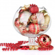 Glass bowl filled with christmas decorations, isolated on white — Stock Photo #29521537