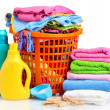 Clothes with detergent and washing powder in orange plastic basket isolated on white — Stock Photo #29522489