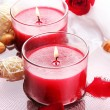 Beautiful red candles with flower petals in water — Stock Photo #29523141