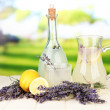 Stock Photo: Lavender lemonade in bottle and jug, on bright background