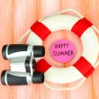 Stock Photo: Lifebuoy on color wooden background