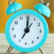 Alarm clock on table on bright background — Stock Photo #29523693