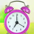 Alarm clock on table on light background — Stock Photo #29523727