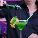 Portrait of handsome barman preparing cocktail, at bar — Stock Photo
