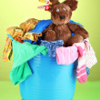 Stock Photo: Blue laundry basket on green background