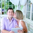 Stock Photo: Young couple taking photo with tablet in restaurant