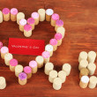 Stock Photo: Wine corks laid out in form of heart on wooden table close-up