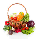 Fresh vegetables in wicker basket isolated on white — Stock Photo