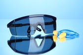 Eyeglasses tools and earplugs on blue background — 图库照片