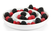 Ripe raspberries and blackberries in plate isolated on white — Stock Photo