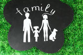Family from paper on wooden board — Stockfoto