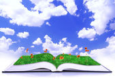 Open book of nature over blue sky with clouds — Stockfoto